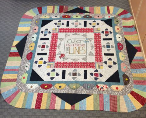 Terris quilt with throw away border